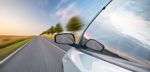 A view of a car passing by the road
